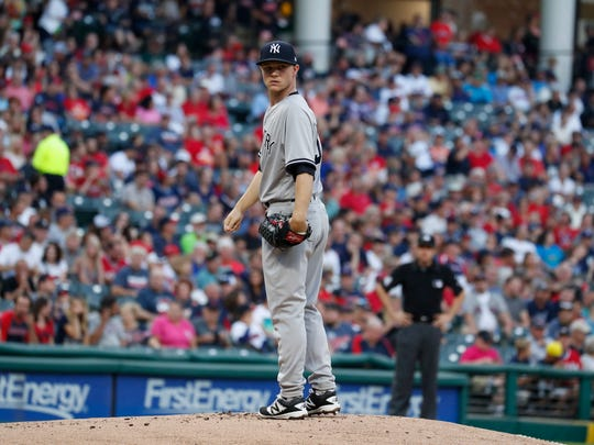 Yankees pitcher Sonny Gray (55) looks over at first