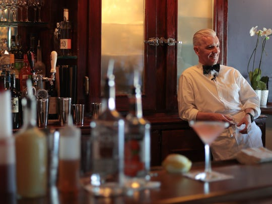Paul O'Halloran, owner of Paul Bar, talks behind the bar in Palm Springs, Calif. on May 31, 2018.