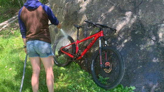 Cleaning mud and seeds off of recreation equipment can be as easy as spraying it with water.