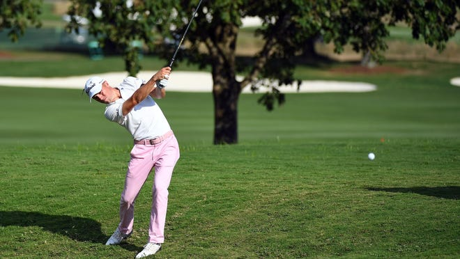 Justin Thomas plays his shot from the 18th fairway on his way to a victory in the WGC  FedEx St. Jude Invitational golf tournament in Memphis, Tenn.