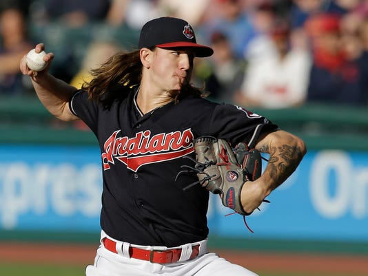Cleveland Indians starting pitcher Mike Clevinger delivers in the first inning of a baseball game against the Texas Rangers, Tuesday, June 27, 2017, in Cleveland. (AP Photo/Tony Dejak)