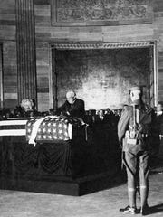 President Warren G. Harding places a wreath on the casket of an unknown soldier from World War I in the rotunda of the U.S. Capitol, on Nov. 11, 1921.