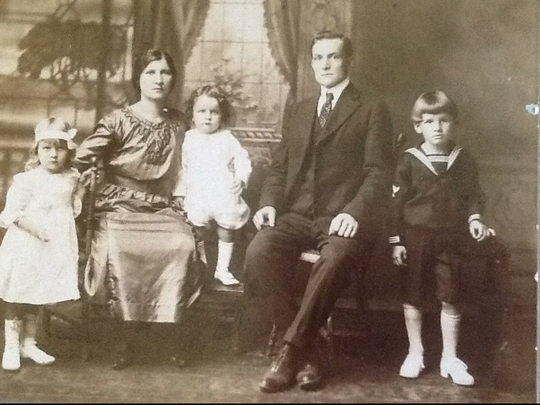 Adolph Miller, second from right in suit, as a young father with his family in an undated photo.