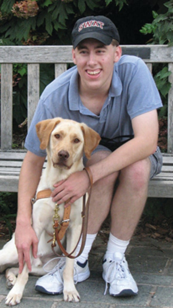 Hayden Dahmm, 22, a Swarthmore senior honors engineering major. He is joined in the second photo by his Seeing Eye dog, named Fathom. Both photos are provided courtesy of the Swarthmore College Communications Office with Hayden's knowledge and permission. They were taken by Laurence Kesterson.