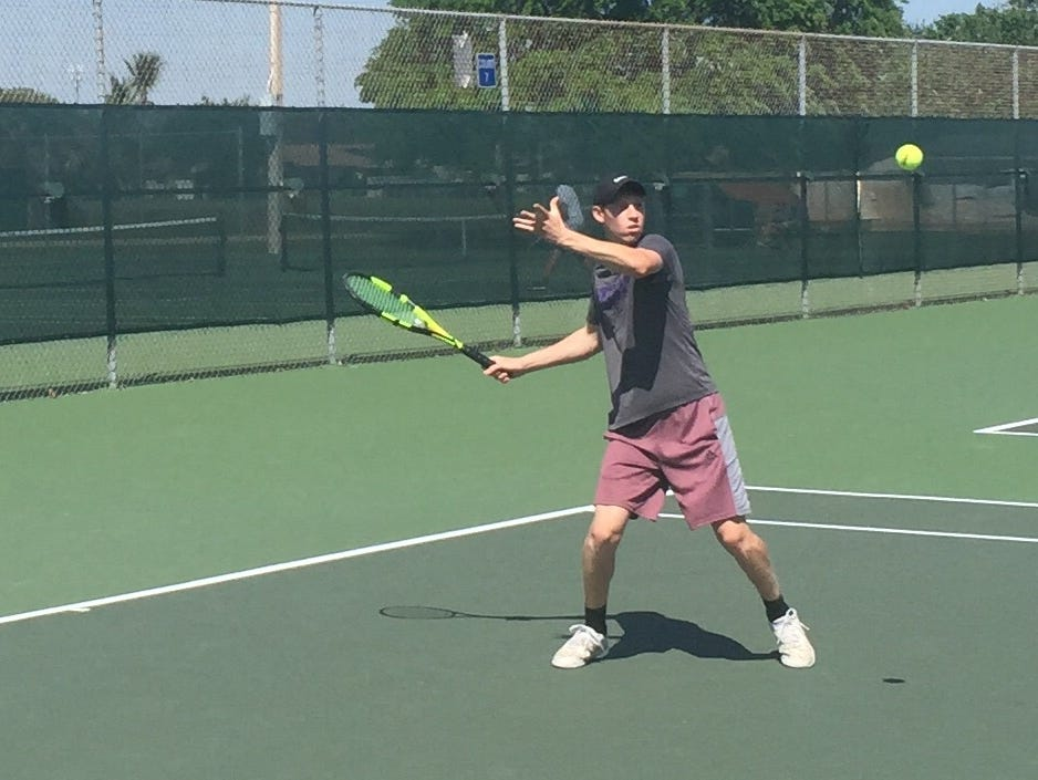 Cypress Lake senior Zachary Blythe returns a forehand on Tuesday during the Panthers Region 2A-6 match against Lemon Bay. Cypress Lake won 5-0.
