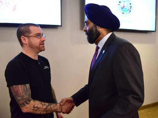Ben Kimmel, left, an addiction recovery specialist, and Bergen County Prosecutor Gurbir S. Grewal talk after Monday's press conference, where Grewal announced the new program coming to three police departments.