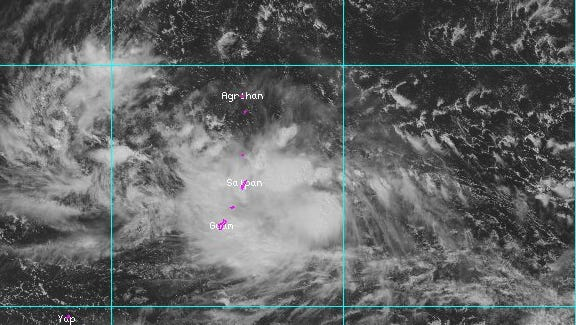 A tropical disturbance positioned 360 miles east of Guam on the morning of Oct. 12 is expected to bring rain and wind to the Marianas as it rolls through the islands.
