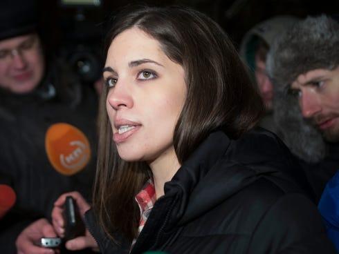 Nadezhda Tolokonnikova speaks to the media after leaving prison in Krasnoyarsk, Russia, Dec. 23.