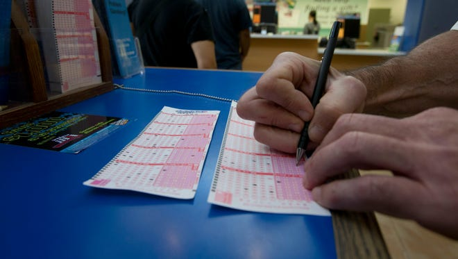 A lottery player fills out a Powerball  ticket.