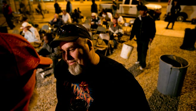 In this photo from 2012, Pastor Jack Moriarty talks with the homeless attending his church's Breakfast Club, an early-morning outreach program.