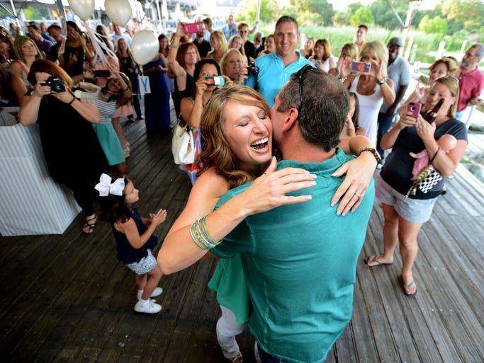 Amy Bowers and Shawn Brown are announced Pensacola Blockparty Wedding winners Wednesday night at the Fish House. The couple will be married on September 19, during a Gallery Night, at the corner of Palafox and Intendencia Street. The wedding and reception is being donated by local venders for an estimated price of $50,000.