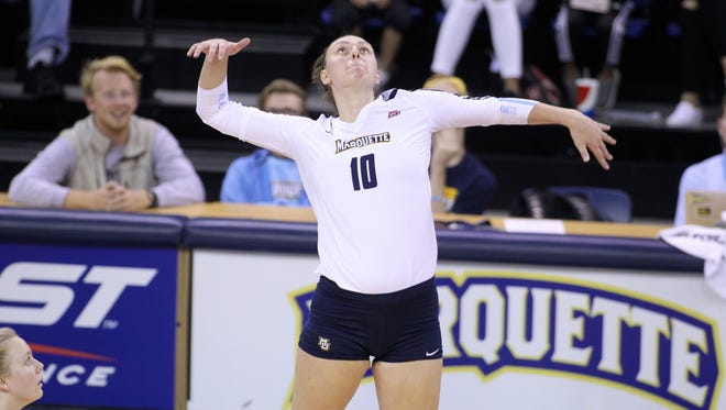 Allie Barber goes up for an attack during the 2017 season for Marquette University volleyball.