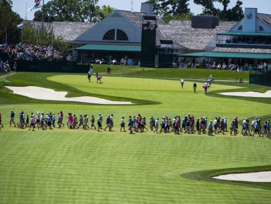 "Fans walk across the 18th fairway during Friday's second round of the 2015 U.S. Women's Open at Lancaster Country Club. Known as ""Pearly Gates,"" the 18th hole has been giving many golfers trouble throughout this week's tournament."