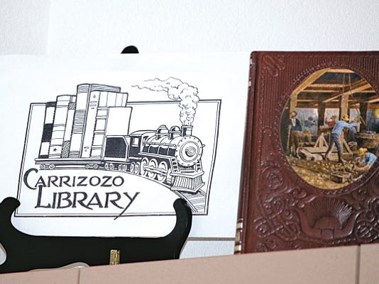 The sign, reflecting Carrizozo's past, is courtesy of Carrizozo artist, Rick Geary.