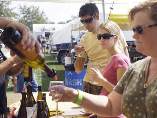 Tracey Celi of Frederick, Maryland, pours a sample of Pinot Grigio at the Moon Dancer Winery booth at the Gettysburg Wine and Music Festival in 2007.