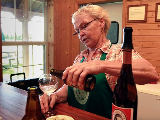 Carol Wiersma, co -owner of Maiden Rock Winery & Cidery, near Stockholm, pours a glass of hard cider. Maiden Rock grows apples and makes wine, hard cider, and jams. Vineyards and wineries are becoming popular attractions all along Wisconsin's Great River Road, that runs along the Mississippi River.