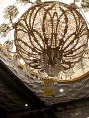 A crystal chandelier at the former Trump Taj Mahal casino in Atlantic City N.J. is tagged with a $7,500 price tag on Thursday July 6, 2017 during a sale of the casino hotel's contents.