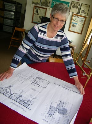 Judy Gill holds plans for the new Clyde Historical Museum addition to be constructed this summer.