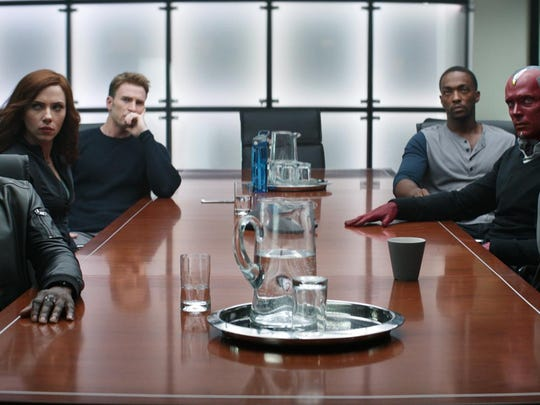 "Don Cheadle, from left, Scarlett Johansson, Chris Evans, Anthony Mackie, Paul Bettany and Elizabeth Olsen appear in ""Captain America: Civil War."""