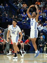 Kentucky's PJ Washington and Shai Gilgeous-Alexander celebrate in the second half as the Wildcats took a commanding lead over Georgia  Friday afternoon in the 2018 SEC Tournament at the Scotttrade Center in St. Louis. Washington had 18 points and  Alexander finished with 15 points. The Wildcats eliminated the Bulldogs from the tourney for the fourth time in five years.