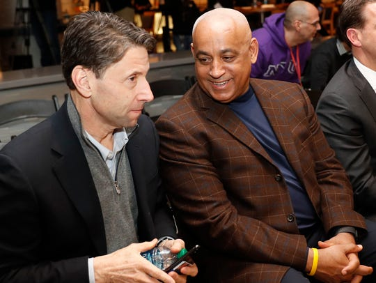 New York Mets owner Jeff Wilpon, left, listens to Mets special assistant to the General Manager, Omar Minaya after the Mets introduced their new third baseman, Todd Frazier, during a press conference in New York in February.