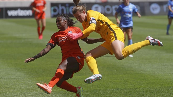 Chicago Red Stars goalkeeper Alyssa Naeher, right, battles for position with Houston Dash forward Nichelle Prince during the second half of Sunday's NWSL Challenge Cup final in Sandy, Utah. Austin was the No. 9 TV market in the country for the match.