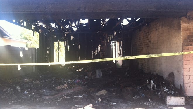 A family of five was displaced early Thursday morning after a neighboring fire extended onto their property in northwest Phoenix, according to a fire department spokesman.