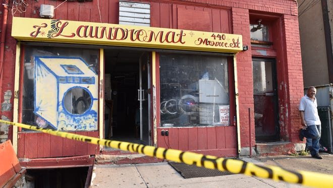 A fire at a building on Monroe St in Passaic on Tuesday morning July 3, 2018.