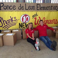 Holley Sinn and Jim van Fleet from 10 News helped deliver classroom supplies to Ponce de Leon Elementary School.