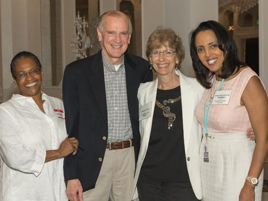 Nikki Clark, Jim Sandman, Kris Knab and Nina Ashenafi at celebration in honor of Knab's retirement from Legal Services of North Florida. Kris worked at LSNF for 38 years.