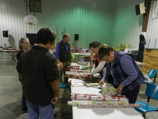 Volunteers wrap gifts at the Salem Baptist Christmas