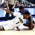 Purdue guard Johnny Hill (1) battles for a loose ball against Florida guard DeVon Walker (back) during the first half at Mohegan Sun Arena.