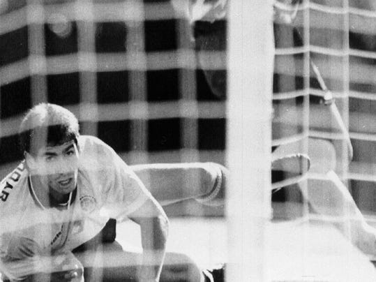 FILE - In this June 22, 1994 file photo, Colombia's Andres Escobar, lies on the ground and watches as a shot by America's Eric Wynalda misses the goal, during their World Cup soccer match, in the Rose Bowl, Pasadena, USA. The US defeated Colombia by 2-1. On this day: July 2, Escobar was shot dead in his home town of Medellin. The killing appeared to be directly linked to Escobar's own goal scored during Colombia's 2-1 defeat to the US. As a result, Colombia returned home early from a tournament many had expected it to do well in. (AP Photo/Eric Draper, File)