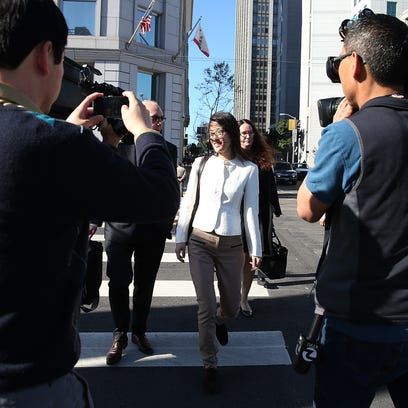 Ellen Pao (C) leaves the San Francisco Superior Court