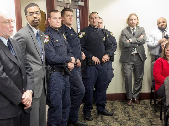 York City Police were among those watching the mayor give her announcement at city hall Tuesday.
