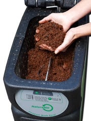 An automatic compost bin to make compost fertilizer on your kitchen counter top.