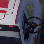 Kyle Larson holds his wheel as he spins through the grass in California.