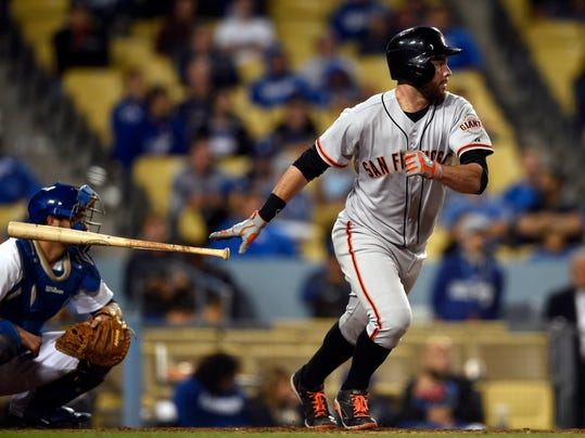 San Francisco Giants' Brandon Belt drops his bat after hitting a RBI-single during the 10th inning of a baseball game against the Los Angeles Dodgers in Los Angeles, Thursday, May 8, 2014. (AP Photo/Kelvin Kuo)