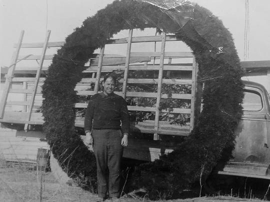 "William Jones, son of the ""Jones, the Holly Wreath Man"" company founder is pictured here with a wreath that hung on Rockefeller Center in 1951."
