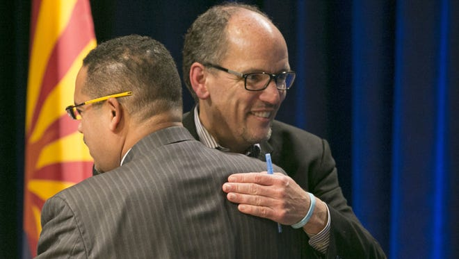 Former U.S. Secretary of Labor Tom Perez (right), a candidate for the Democratic National Committee chair, hugs U.S. Rep. Keith Ellison of Minnesota, also a candidate also for the DNC chair. They embraced at a DNC Future of the Party Forum in Phoenix Hotel last month.