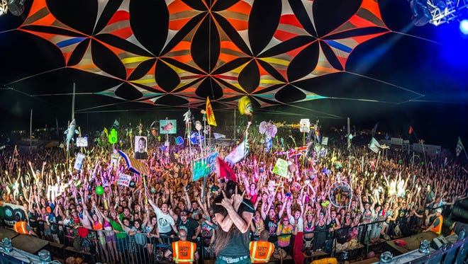 Bassnectar poses with fans at the Summer Camp Music Festival in Chillicothe, IL.