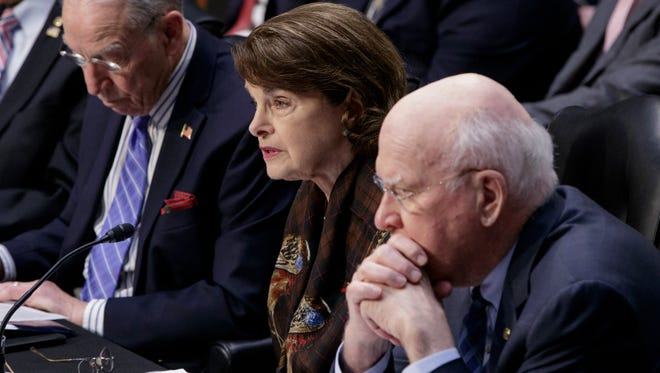 Sen. Dianne Feinstein, D-Calif., the ranking member of the Senate Judiciary Committee, flanked by the Committee's Chairman Sen. Charles Grassley, R-Iowa, left, and Sen. Patrick Leahy, D-Vt., speaks in opposition of the nomination of President Donald Trump's Supreme Court nominee Neil Gorsuch, Monday, April 3, 2017, on Capitol Hill in Washington.