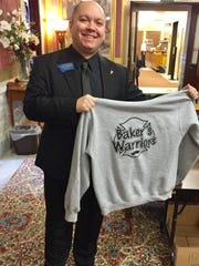 Rep. Casey Schreiner, D-Great Falls, holds up a shirt in support of Jason Baker.