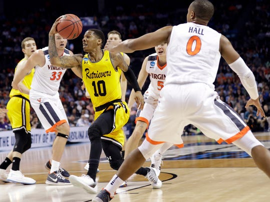 UMBC's Jairus Lyles (10) drives past Virginia's Devon Hall (0) during the second half of a first-round game in the NCAA men's college basketball tournament in Charlotte, N.C., Friday, March 16, 2018. (AP Photo/Gerry Broome)