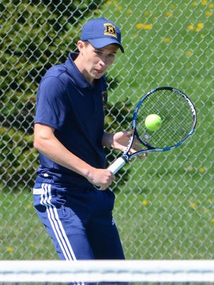 Marquette's John Massart returns a shot in the No. 1 doubles championship match on Saturday afternoon.
