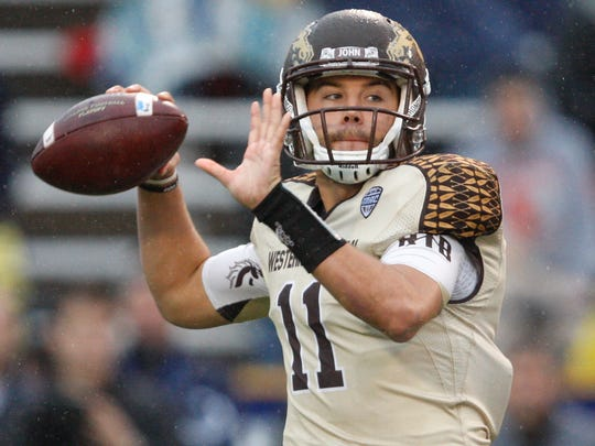 Western Michigan Broncos quarterback Zach Terrell throws a pass against the Toledo Rockets at Glass Bowl.
