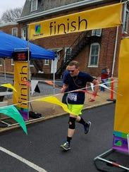 Chambersburg's Dave McLucas crosses the finish line