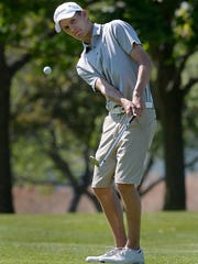 Kendall's Evan Gaesser chips on to the ninth green during the Section V SuperSectionals held at Clifton Springs Country Club on May 23, 2016.