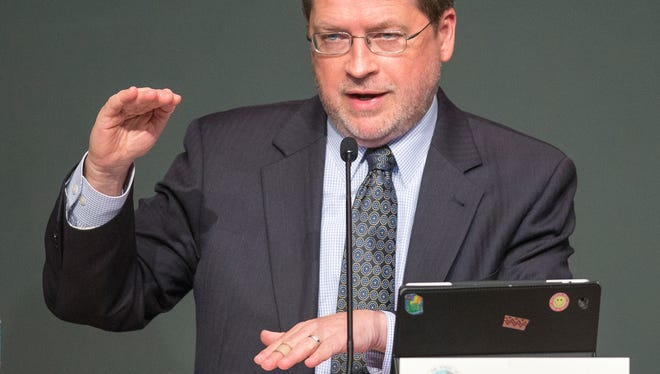 Grover Norquist, representing Americans for Tax Reform, gestures during the Indiana Tax Competitiveness and Simplification Conference at Indiana Government Center South Conference Center, Indianapolis, on June 24, 2014.
