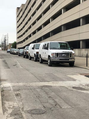 A few metered parking spots on E. Wabash Street, east of Whole Foods.